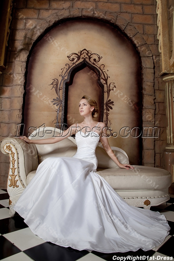 Ivory cheap beautiful wedding dresses with spaghetti for Cheap but beautiful wedding dresses